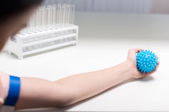 Woman preparing for blood analysis by flexing rubber ball Stock Photos