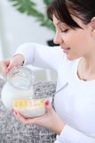 Woman preparing breakfast Stock Images