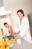 Woman preparing breakfast in the kitchen Stock Photo