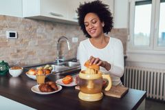 Woman preparing breakfast in kitchen royalty free stock image