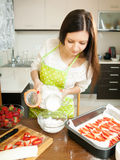 Woman preparing  cake Stock Photo