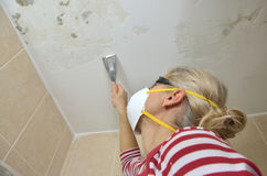 Woman Preparing Ceiling for Smoothing Royalty Free Stock Photo