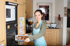 Woman preparing chestnuts for roasting Stock Photo