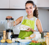 Woman preparing chicken pate Royalty Free Stock Images