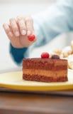 Woman preparing chocolate cake Stock Images