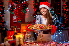 Woman preparing for Christmas dinner Royalty Free Stock Images