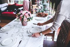 Woman Preparing Christmas Table Royalty Free Stock Images