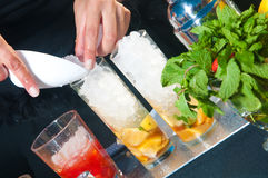 Woman preparing cocktails Stock Photography