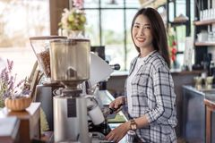 Woman preparing coffee with machine in cafe stock image