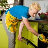 Woman preparing dinner Royalty Free Stock Image