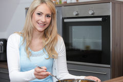Woman preparing dinner in the kitchen Stock Image