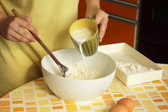 Woman preparing dough Stock Images