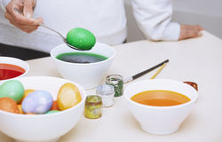 Woman preparing Easter eggs Royalty Free Stock Photos