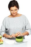 Woman preparing eggs for a dough Royalty Free Stock Photography