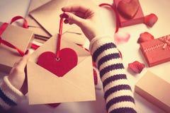 Woman preparing envelope and gift Stock Image