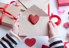 Woman preparing envelope and gift Royalty Free Stock Photos