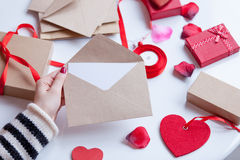Woman preparing envelope and gift Royalty Free Stock Photo