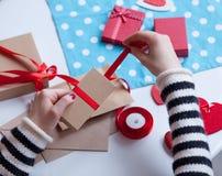 Woman preparing envelope and gift Stock Photos