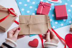 Woman preparing envelope and gift Stock Image
