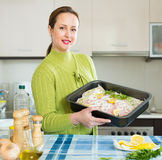 Woman preparing  fish Stock Photo
