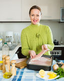 Woman preparing  fish Stock Image