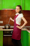 Woman preparing food in the kitchen Royalty Free Stock Photos