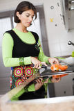 Woman preparing food at the kitchen Stock Image