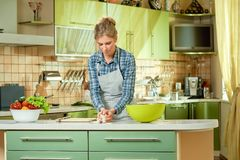 Woman preparing food. Young female and vegetables. Healthy eating guide for beginners Royalty Free Stock Image