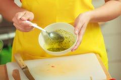Woman preparing fresh salad dressing Royalty Free Stock Photo