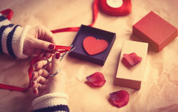 Woman preparing a gift Royalty Free Stock Images
