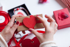 Woman preparing a gift Royalty Free Stock Image