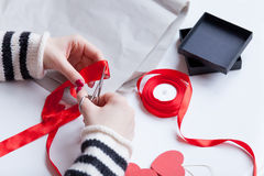 Woman preparing a gift Stock Images