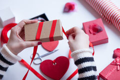 Woman preparing a gift Stock Photos