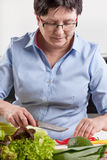 Woman preparing healthy meal Stock Image