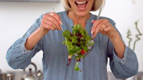 Woman preparing healthy salad stock footage