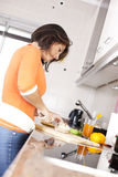Woman preparing her healthy breakfast Royalty Free Stock Photos