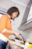Woman preparing her healthy breakfast Stock Photography