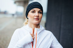 Woman preparing herself for a run. Focused young fitness model in sports wear stock photo