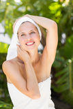 A woman preparing herself for spa day Stock Images