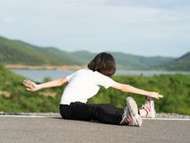 Woman preparing for jogging outdoor Stock Photos