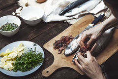 Woman preparing mackerel Stock Photography