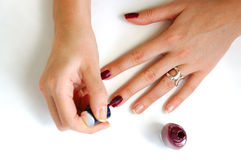 Woman preparing manicure. Two woman`s hands making manicure Royalty Free Stock Photo
