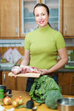 Woman preparing meal at home Royalty Free Stock Photo