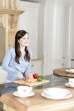 Woman preparing a meal in the kitchen Royalty Free Stock Photos