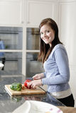 Woman preparing a meal in the kitchen Royalty Free Stock Photo