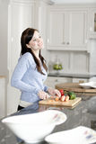Woman preparing a meal in the kitchen Royalty Free Stock Image