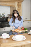 Woman preparing a meal in the kitchen Royalty Free Stock Images