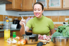 Woman preparing meal in kitchen Stock Photos