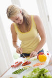 Woman Preparing meal,mealtime Royalty Free Stock Photography