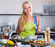 Woman preparing mussels with rice Stock Images